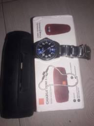 1 relógio orient; caixa de som nova é uma  pulseira