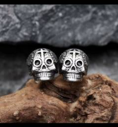 Brincos de aço caveira mexicana