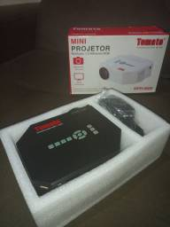 Vendo mini projetor nunca usado