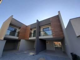 Casa geminada em condominio no Saguaçu (Adriano)