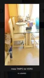 Mesa tampo de vidro com 8 lugares