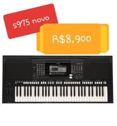 Vendo teclado s975 novo de barbada