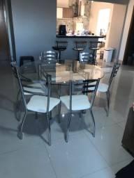 Mesa de alumínio com tampo de vidro redondo com 06 cadeiras