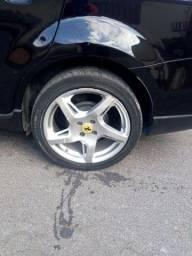 Troco roda modelo Ferrari