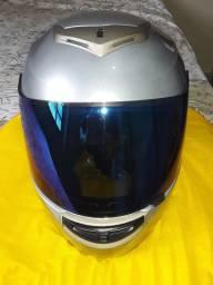 Troco por capacete  fechado  N 58   obs preferência.