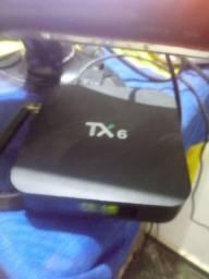 Tv box e video game junto