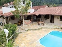 Casa com Piscina/WI-FI a poucos metros da Praia de Garatucaia