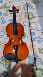 Vende-se violino Semi novo completo .