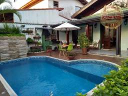 Casa com 3 dormitórios no Canto do Forte em Praia Grande SP, com piscina