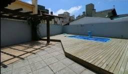 Disponível casa de alto padrão em TORRES com piscina ótima localização