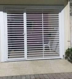 Vendo portão de elevação em alumínio branco 2.90largura x 2.50altura
