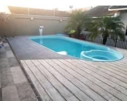 Título do anúncio: Casa terreno inteiro com piscina!