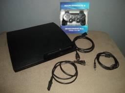 PS3 com jogos e manete nova