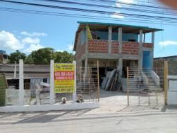 Terreno com ponto comercial e uma casa