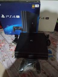 Playstation 4 pro 1TB 4k  cuh7215b controle completo na cx AC trocas battlegames !!!