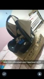 Bebê conforto semi novo junto com a base