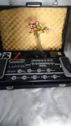Guitarra pedaleira e amplificador