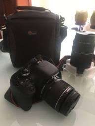 Camera. canon 3ti + bolsa+ lente 75 300
