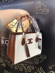 Bolsa De mão e alça transversal de luxo <br><br>R$130,00<br>Entrega grátis