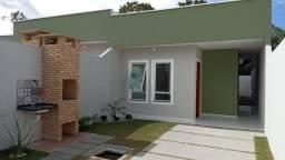 Casa com 3 quartos (Sendo 2 suítes), casa com área ampla, lado da sombra, corredor lateral