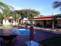 Vende Casa / Sitio com Chale e Ponto Comercial na entrada de Canoa