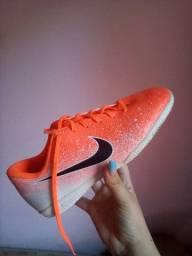 Chuteira Nike Mercurial laranja