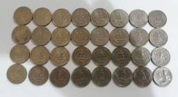 Lote 32 moedas antigas de dólar 0,25c