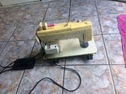 Vendo maquina de costura singer!!
