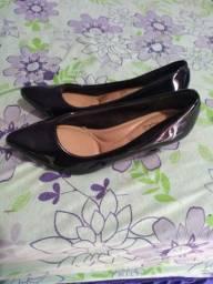As duas sapatilha por 100 reais