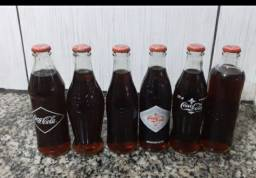 Coleção de garrafas da coca cola