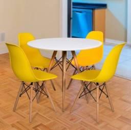 Mesa eames com 4 cadeiras amarelas