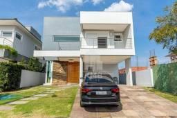 Casa com 4 dormitórios à venda, 271 m² por R$ 1.750.000 - Alphaville - Gravataí/RS