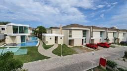 Alugo casa em condomínio localização privilegiada
