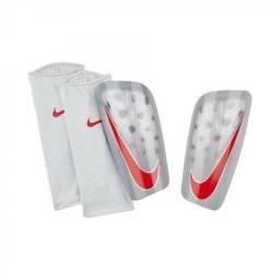 8c8f1043ca1c1 Caneleira Nike Mercurial Lite cza vrm tam pp-p-m