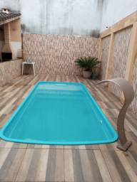 Excelente casa com piscina e área de churrasco em Itaoca Praia