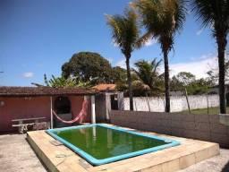 Casa 3 quartos com piscina churrasqueira campo de futebol área de 720m e quitinete