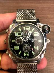 Relógio Espião que grava vídeo e áudio cromado com pulseira tb cromada e bússola Evulon.