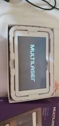Tablet multilaser na caixa com nota .