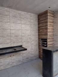 casa 2 quartos  suite  porcelanato  pe direito duplo  varanda churrasqueira
