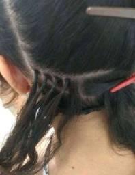 Alongamento de cabelo no método nó italiano