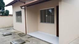 Casa linear com grande área externa 2 quartos