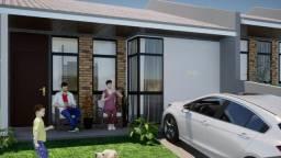 Casa com 62,70 m², terreno 202,74. Laje, porcelanato. Com 07 m de recuo da rua