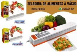 Embaladora / seladora de alimentos a vácuo (grátis 10 embalagens )