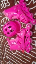 Vende-se Um patins da cor rosa