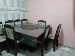 Vende mesa de 8 cadeiras semi nova