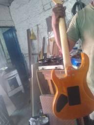 Guitarra Groovin e amplificador Onerr block 20tu