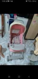 Carrinho de bebê rosa bem conservado