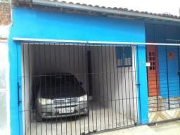 Casa com garagem apenas para trocar em outra