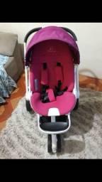Carrinho quinny rosa com marcas de uso