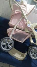 Carrinho de bebê mas pode chamar de nave espacial ou uma maquina